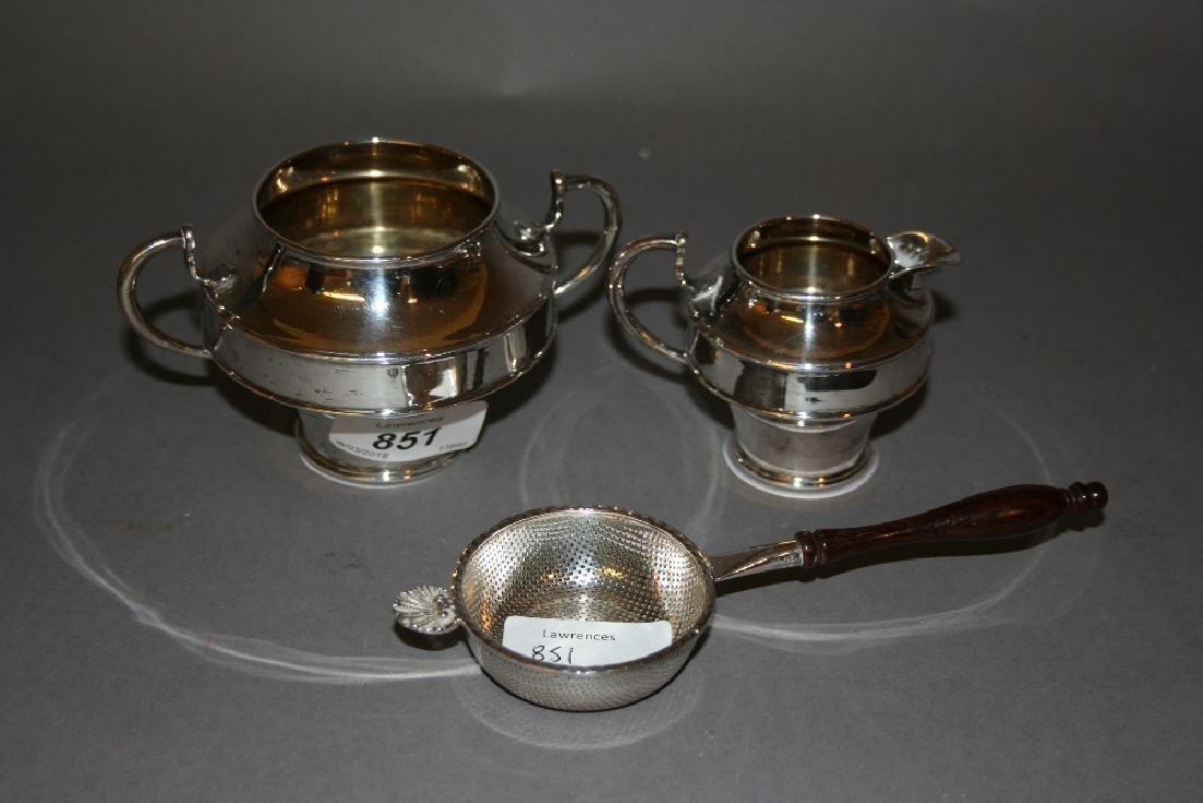 Small silver cream jug with matching sugar basin and a