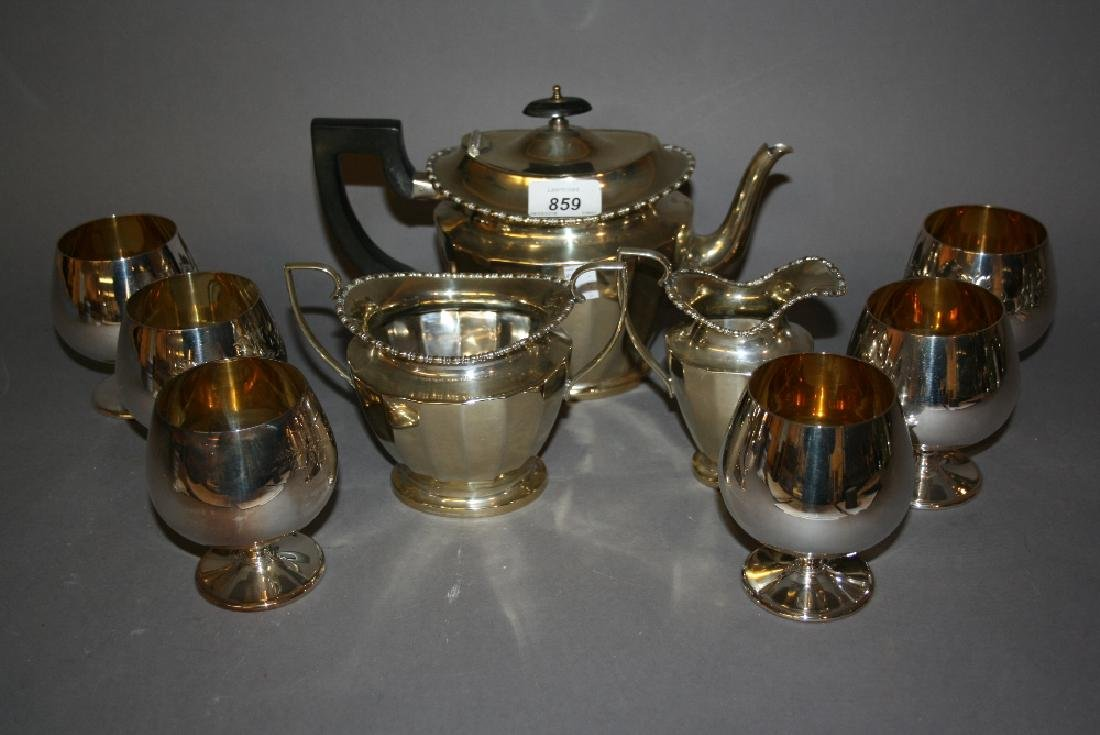Three piece silver plated tea service together with a