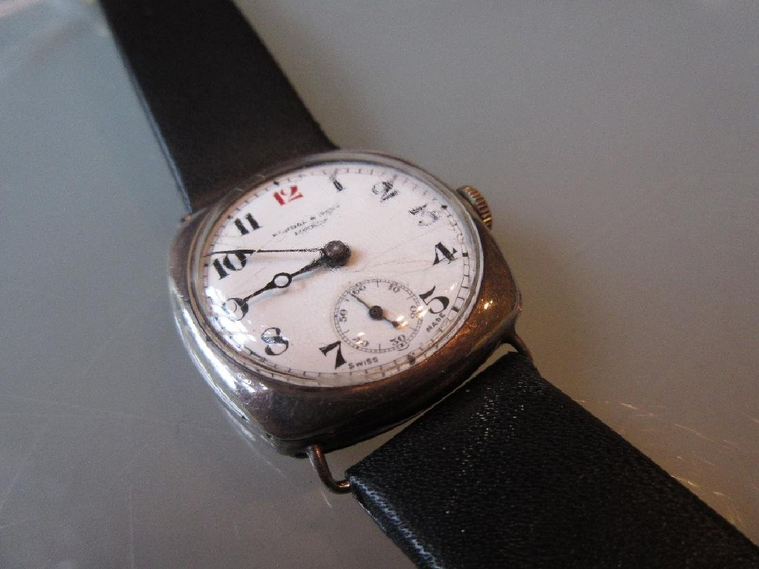 Silver cushion cased wristwatch by Kendal and Dent