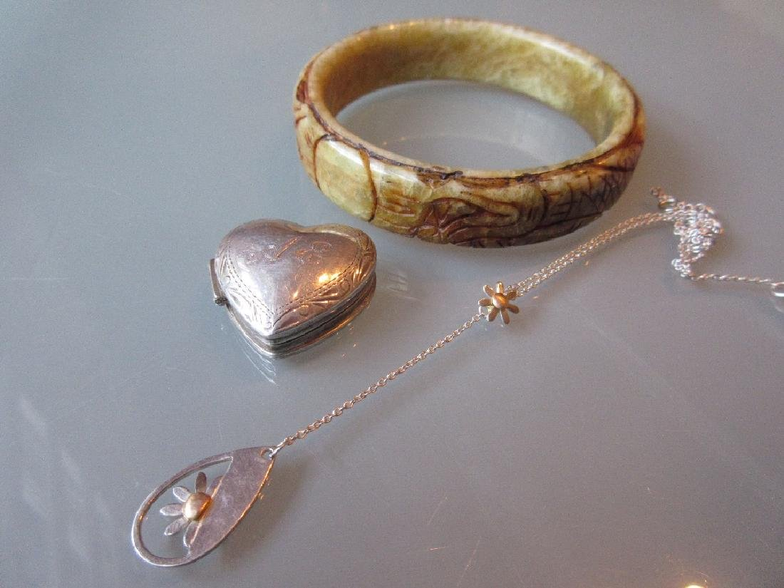 Carved hardstone bracelet, small silver pill box and a