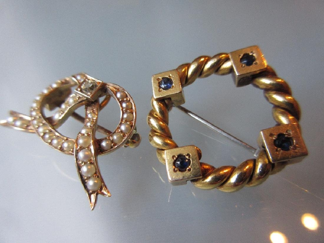 15ct Gold split pearl and diamond set bow brooch and a