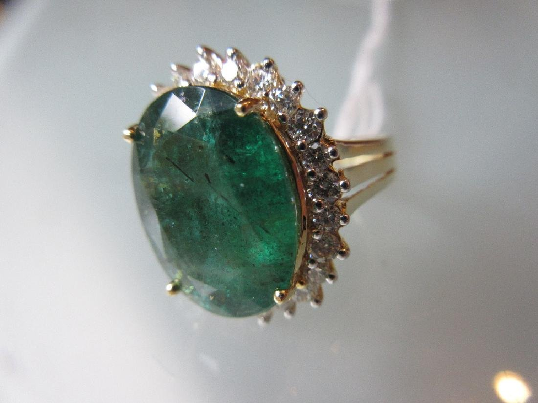 Large 18ct yellow gold oval emerald and diamond cluster