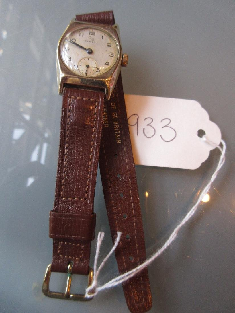 Gentleman's 9ct gold cased Record wristwatch on a brown