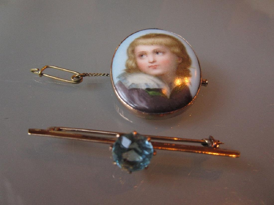 19th Century oval porcelain brooch painted with a