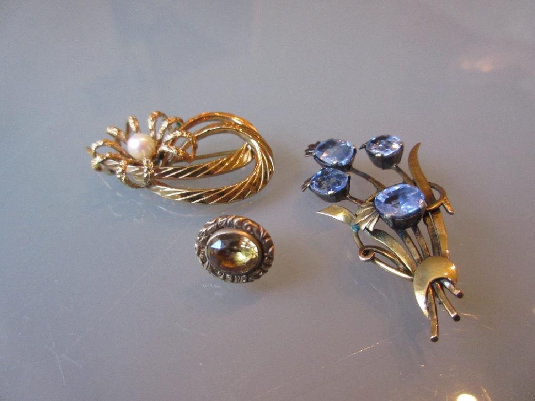 Two yellow metal floral spray brooches and a citrine