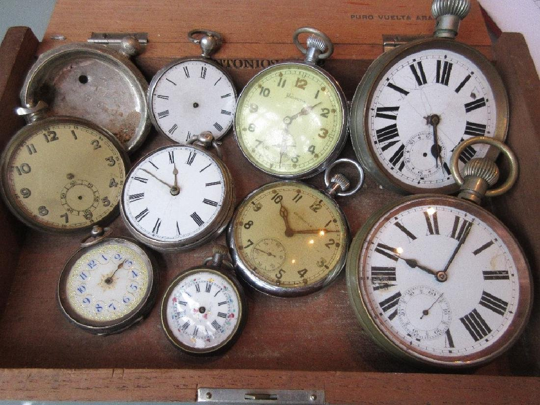Box containing a quantity of various pocket watches,