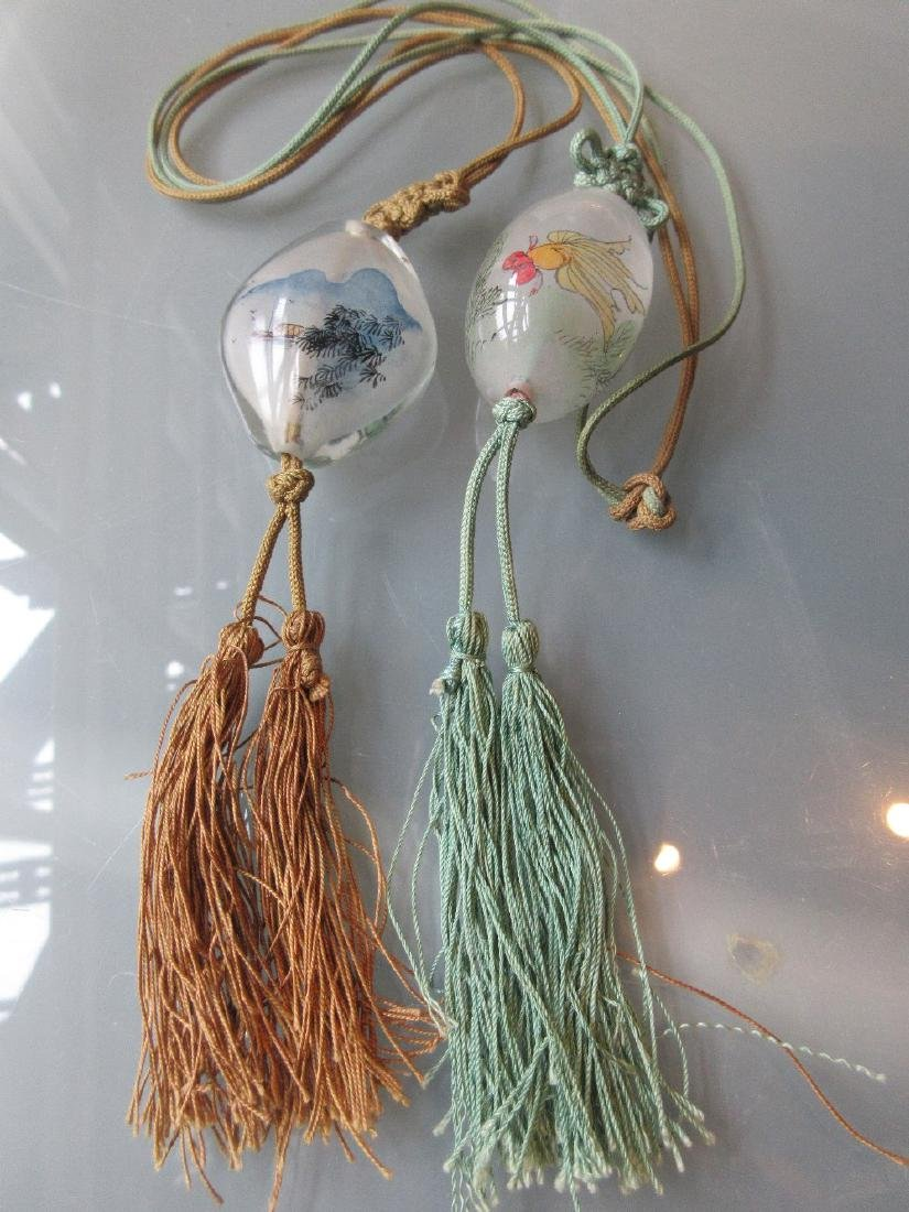 Two Chinese internally painted glass pendant necklaces