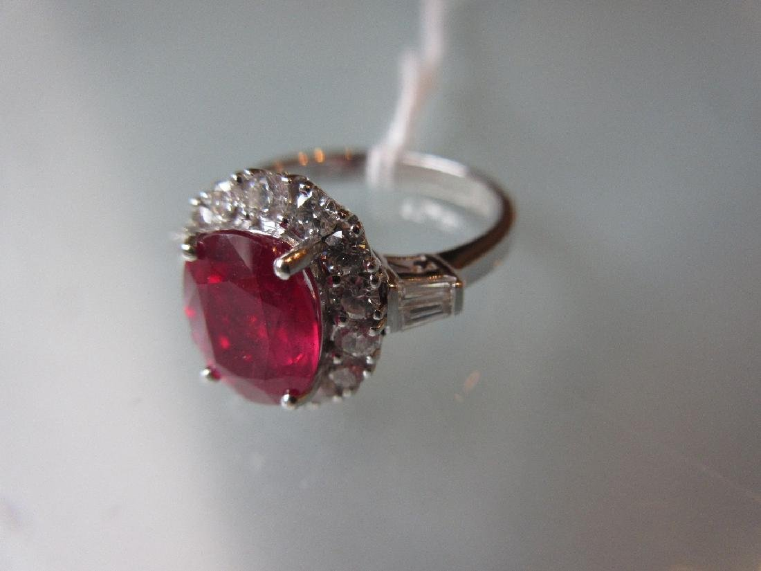 18ct White gold treated ruby and diamond cluster ring,