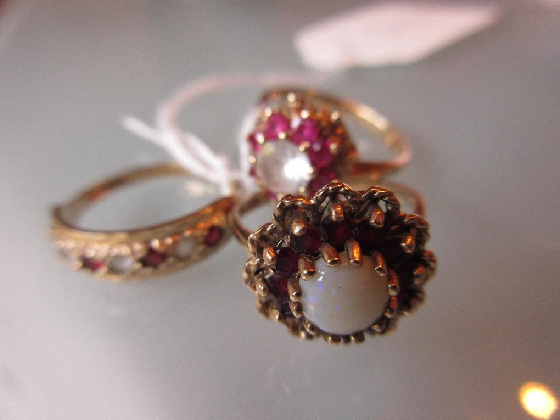 Two 9ct gold cluster dress rings together with a 9ct