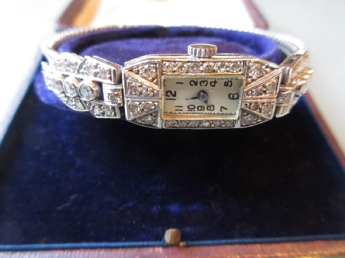 French platinum diamond set ladies cocktail watch on an