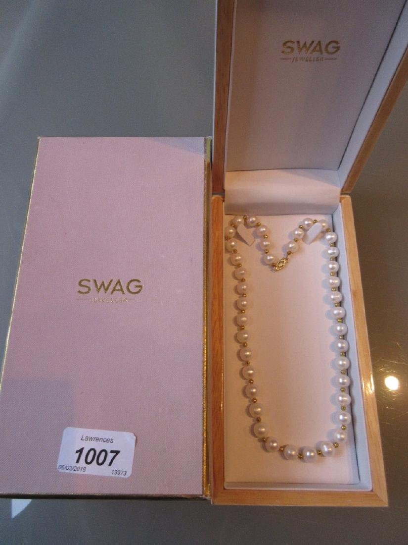 Boxed Swag cultured pearl necklace with a 14ct gold