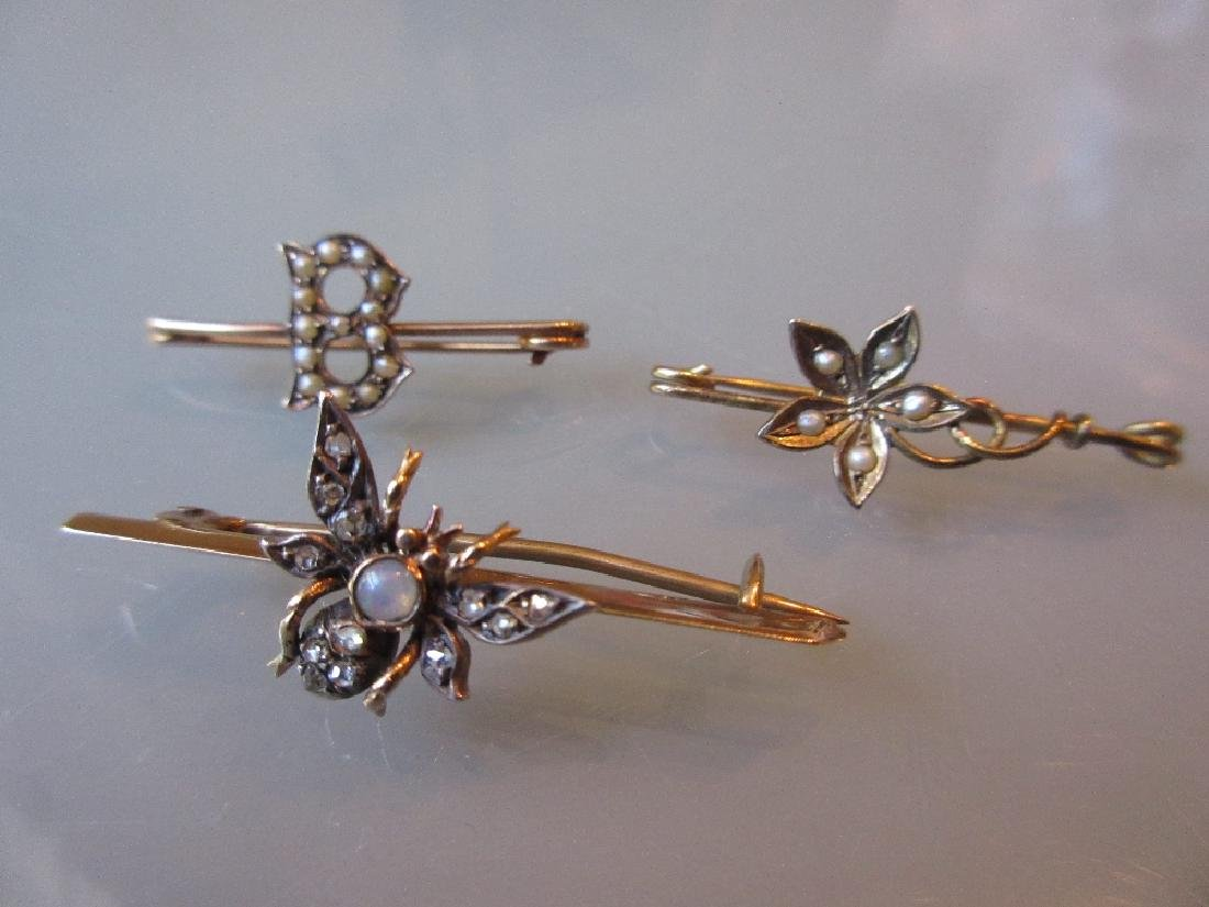 Yellow gold diamond and opal set bar brooch in the form