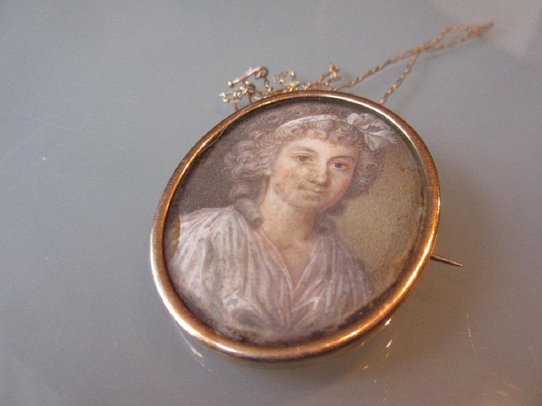 Small oval gold framed miniature head and shoulder