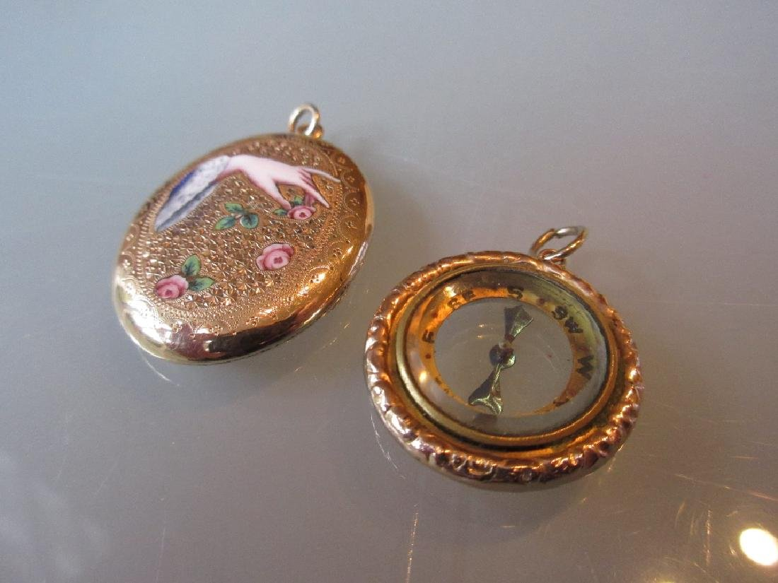 Victorian oval locket, enamel decorated with a hand