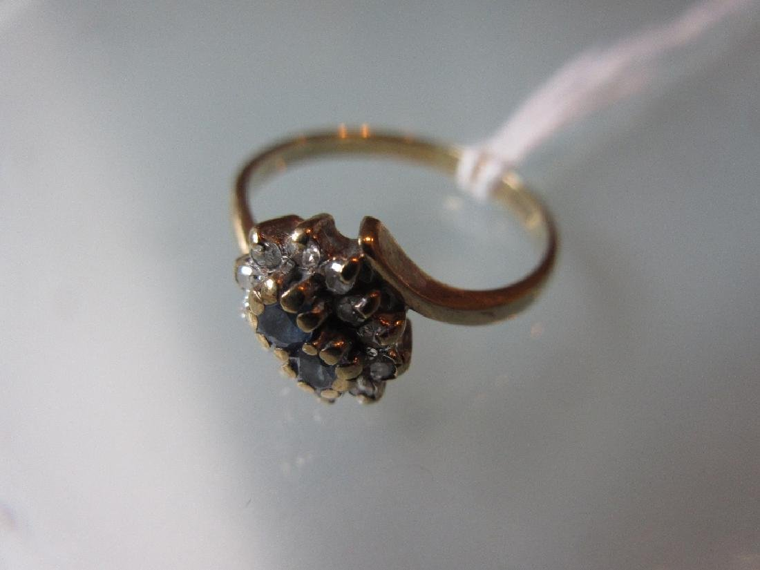 9ct Gold diamond and sapphire crossover ring