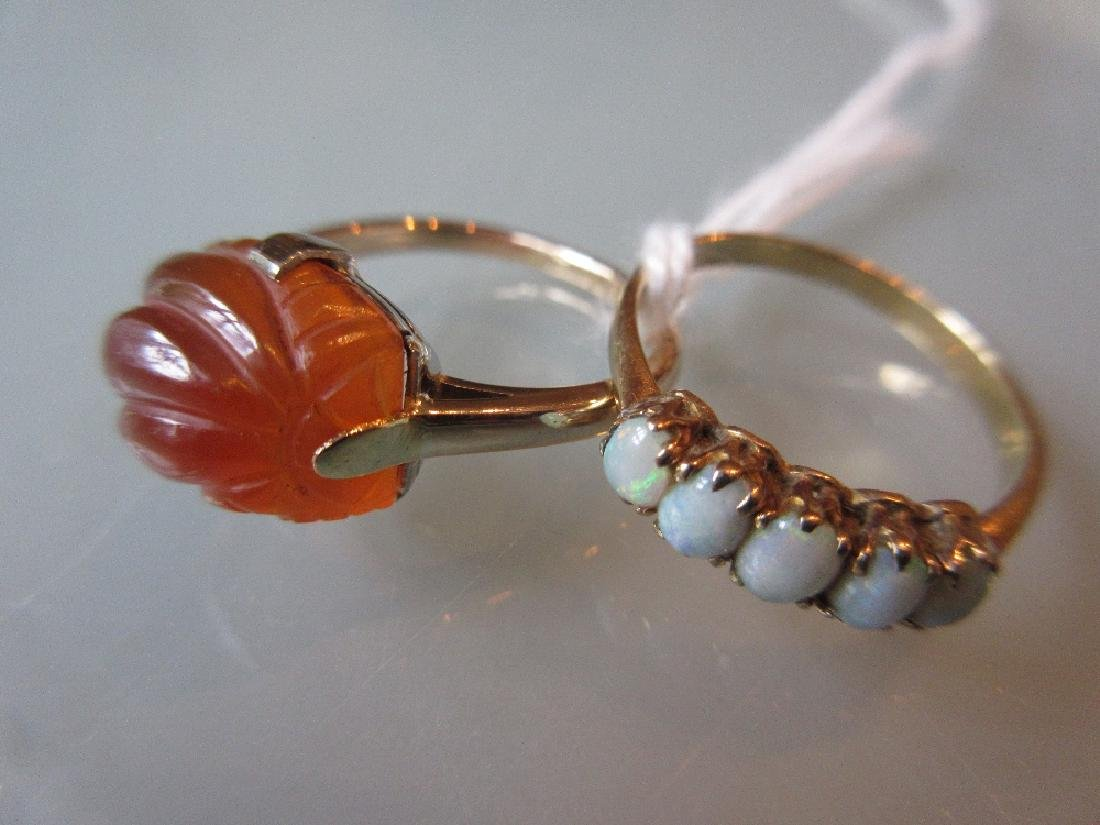 Five stone opal ring together with a carved cornelian