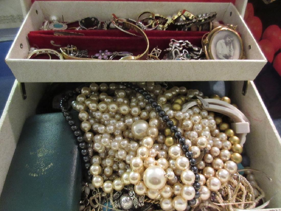Cream jewellery box containing various costume
