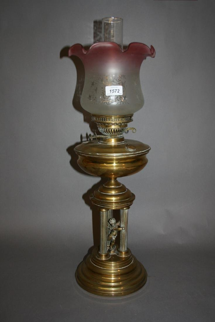 Edwardian brass oil lamp, the base in the form of a