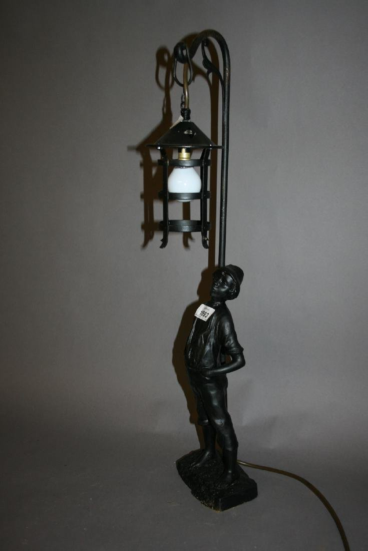 Spelter table lamp in the form of a whistling boy under
