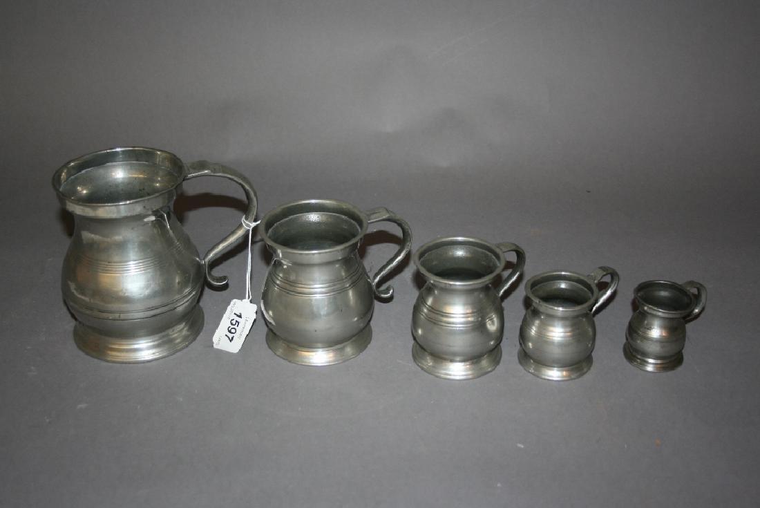 Harlequin set of five Victorian pewter baluster form