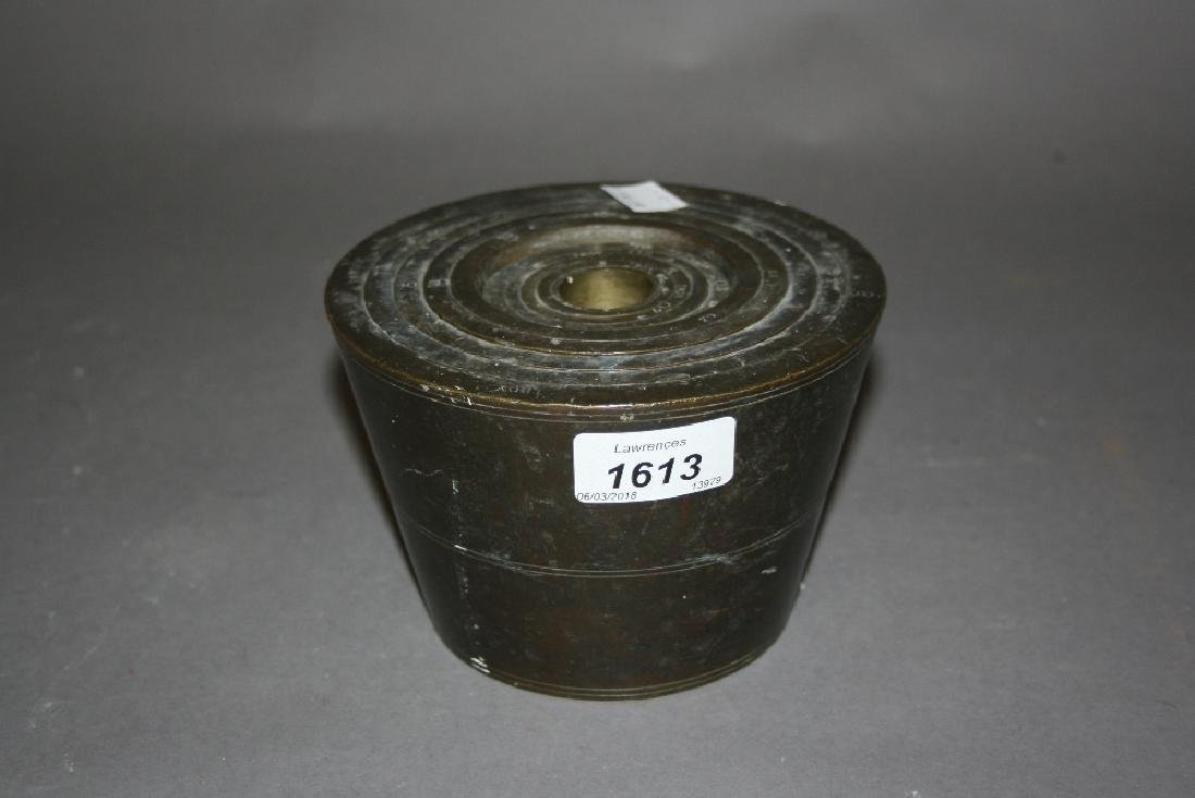 Near set of large bronze troy bucket weights