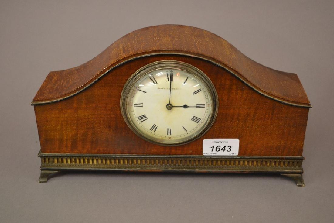 Edwardian mahogany dome shaped mantel clock, the enamel