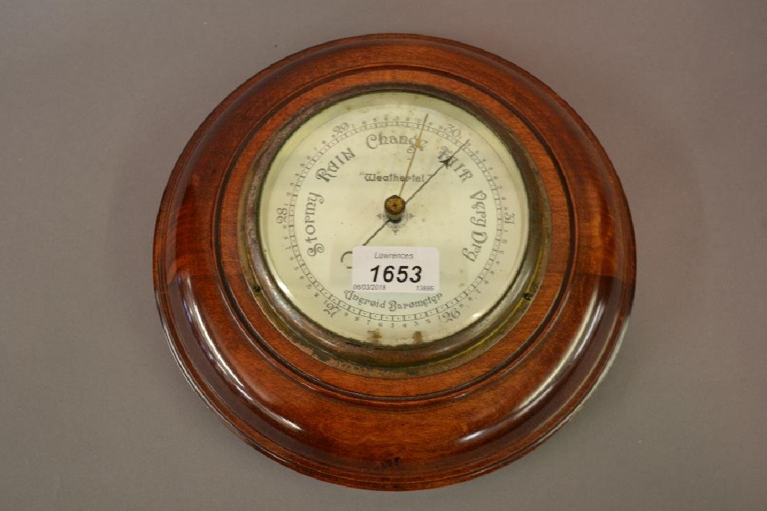 Small circular aneroid barometer