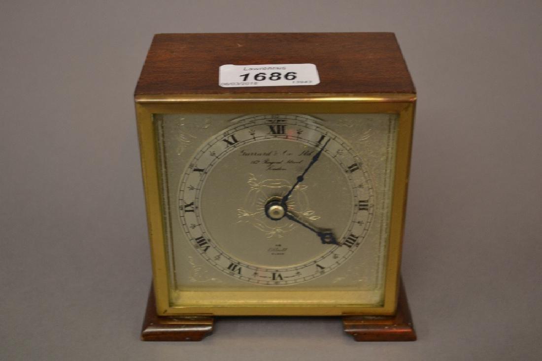 Small mahogany cased mantel clock having silvered dial