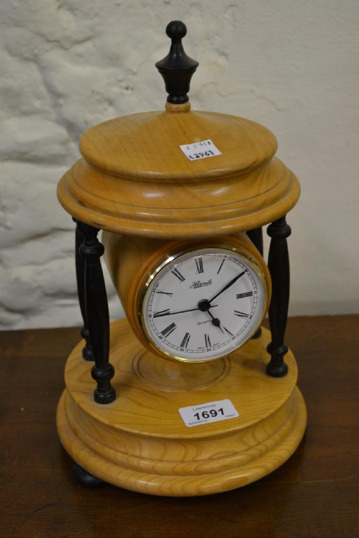 20th Century turned oak and ebony pillar clock with a