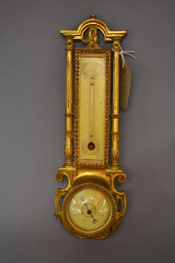 Small carved wooden and gilded barometer thermometer
