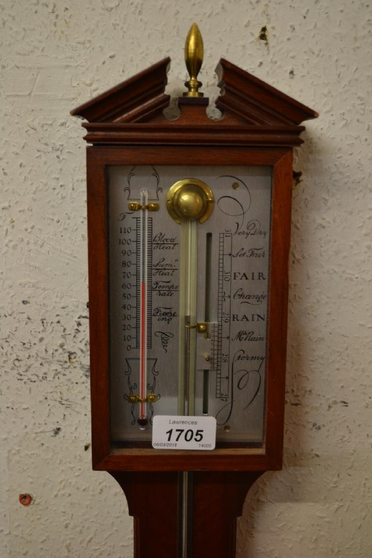 Reproduction mahogany stick barometer in antique style