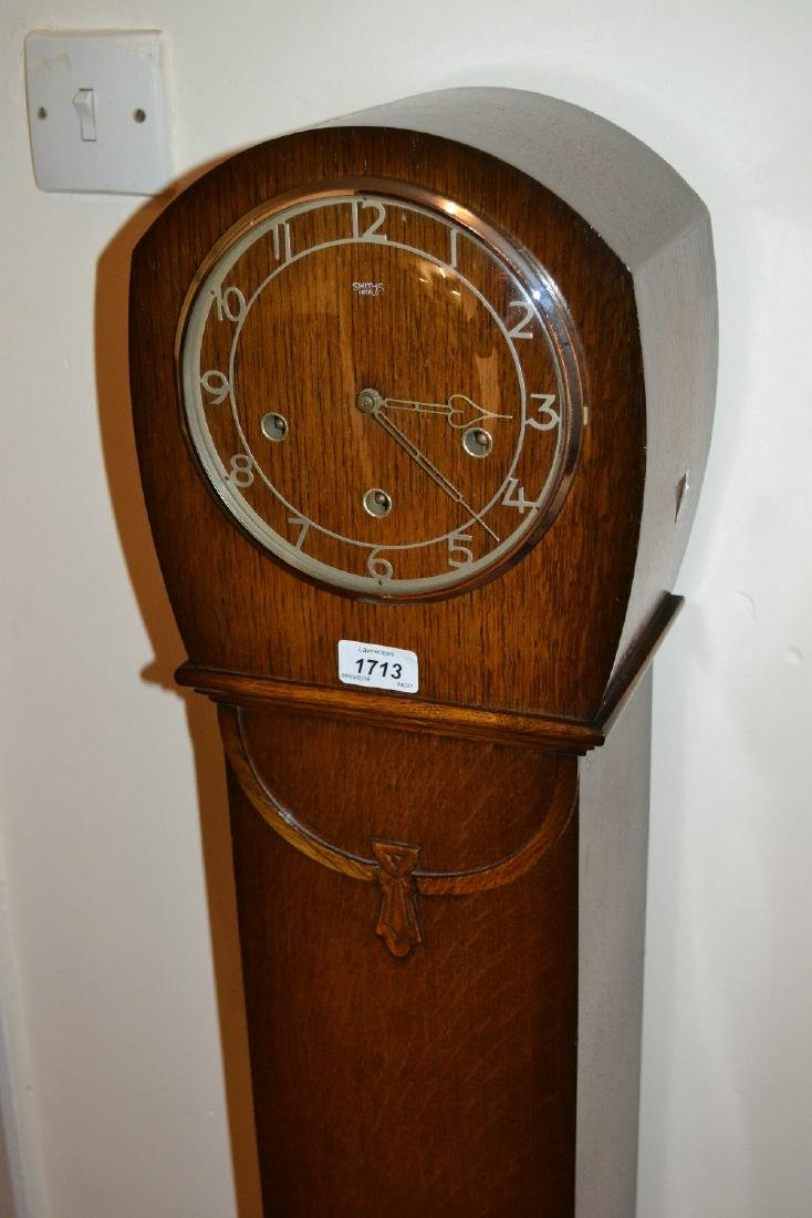 Oak cased three train grandmother clock by Smiths circa