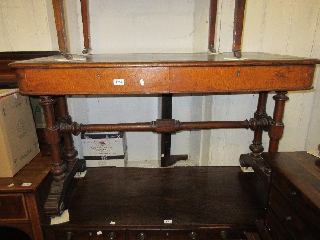 Victorian oak library table having black leather inset