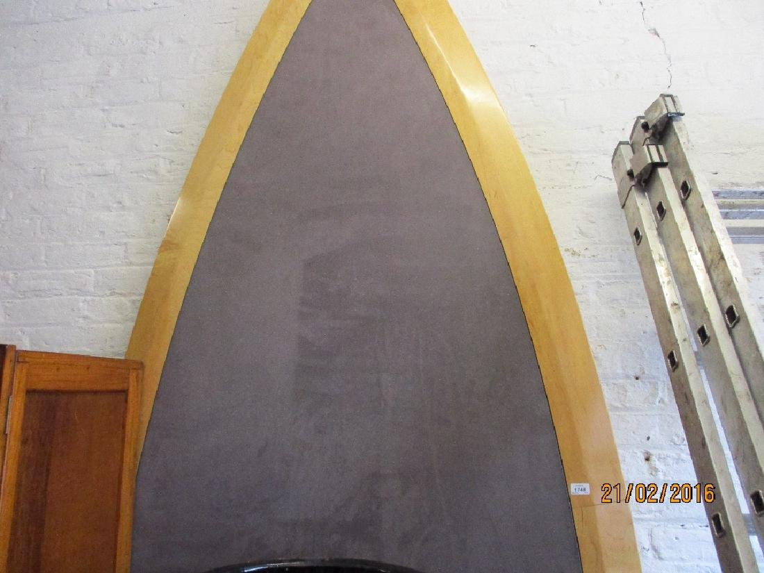 Large modern boat shaped board room table on green