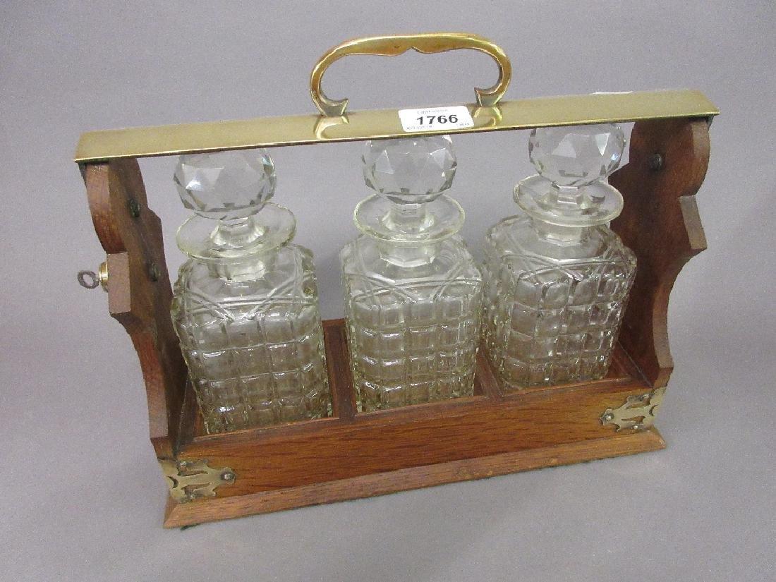 Late 19th / early 20th Century oak three bottle