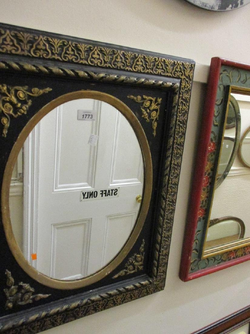 Small rectangular ebonised and parcel gilt wall mirror