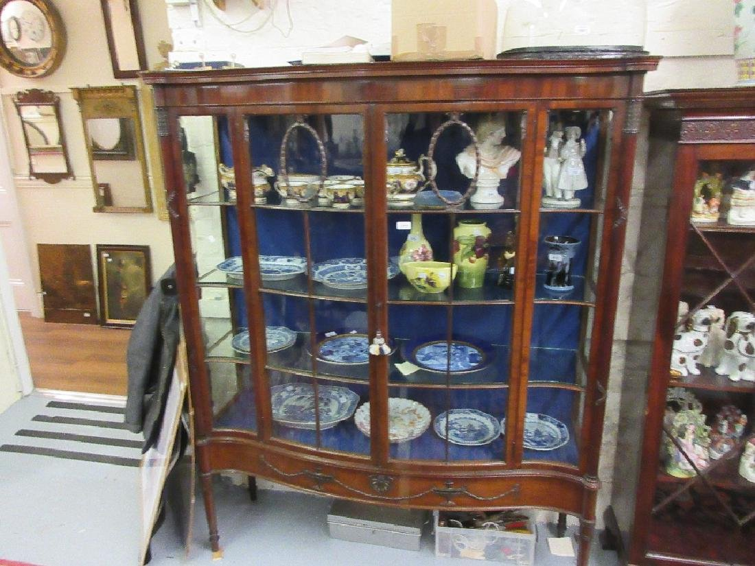 Edwardian mahogany serpentine shaped display cabinet,