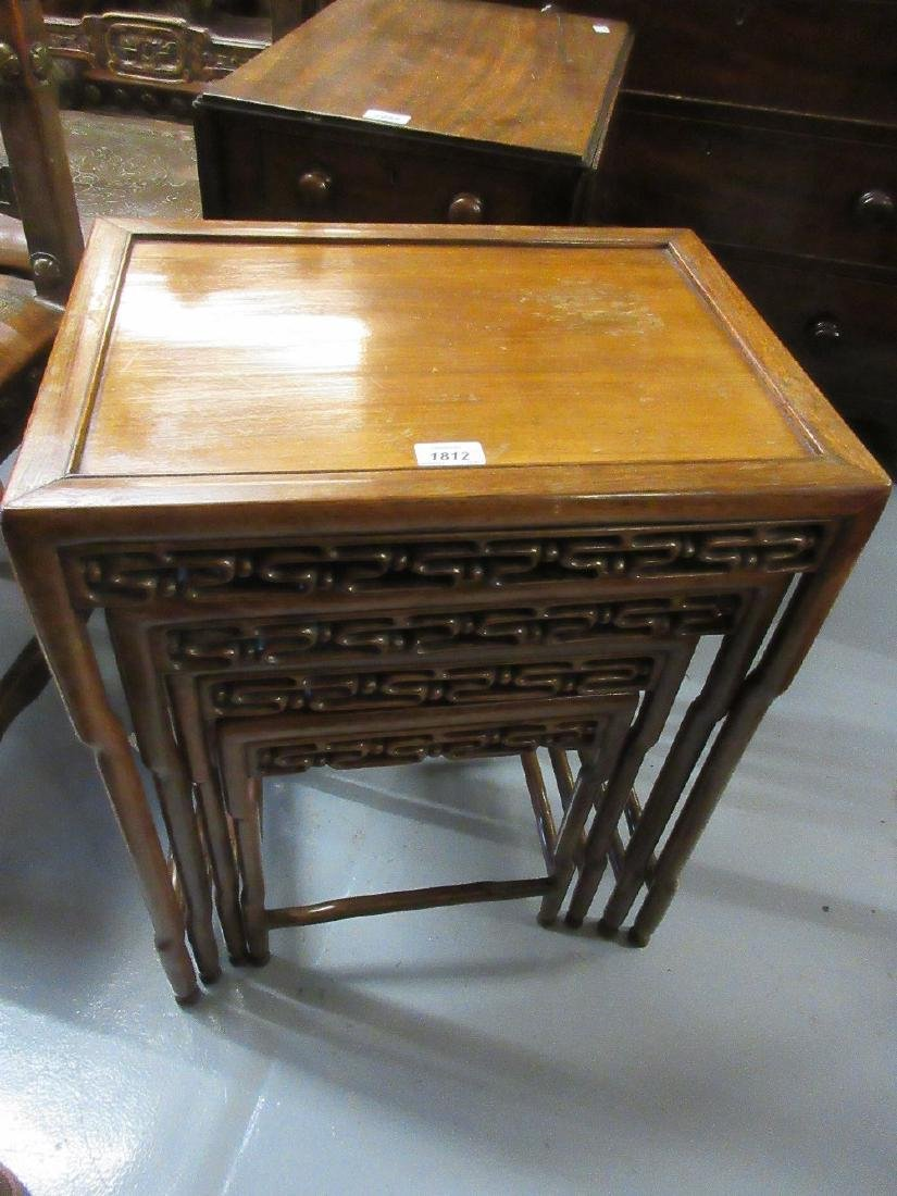 Nest of four Chinese padouk wood occasional tables,