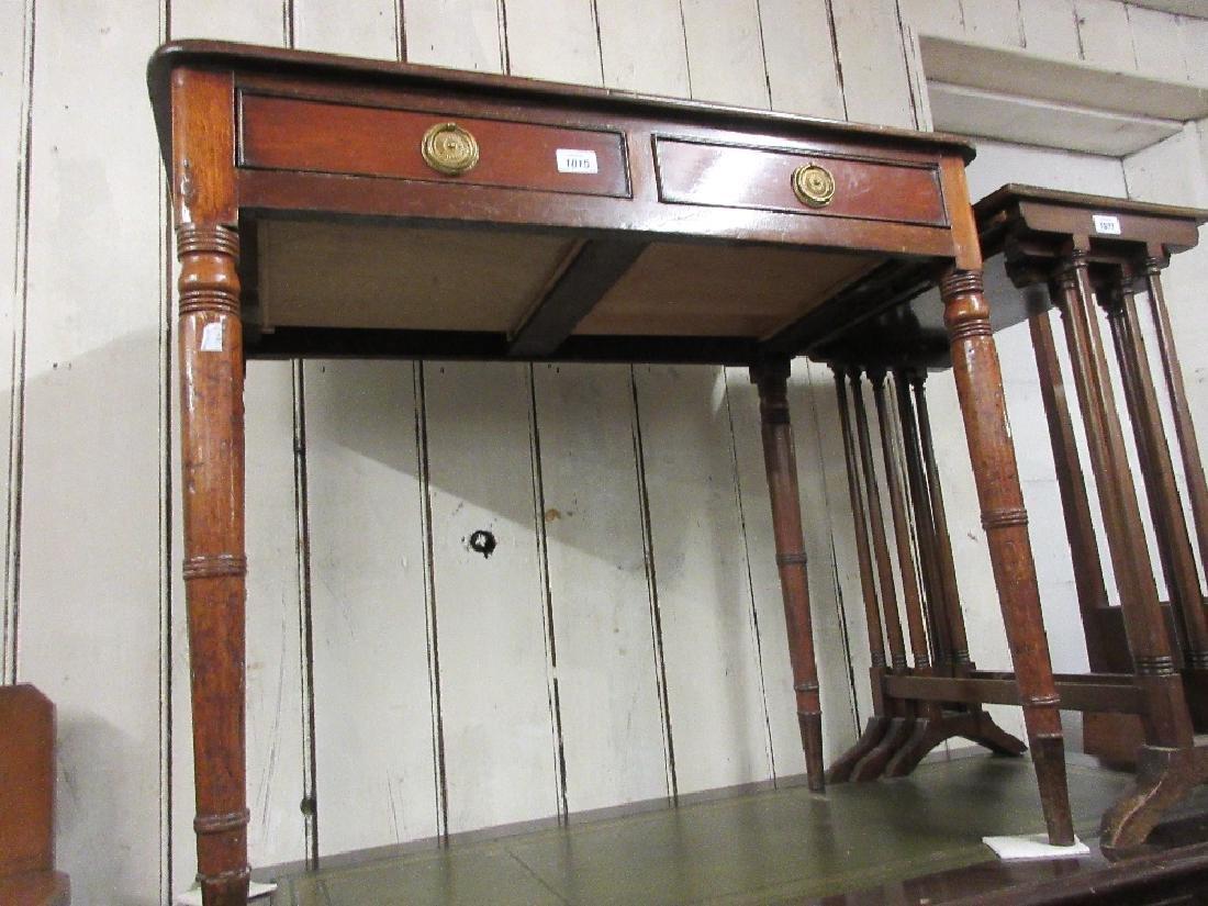Late Georgian mahogany two drawer side table raised on