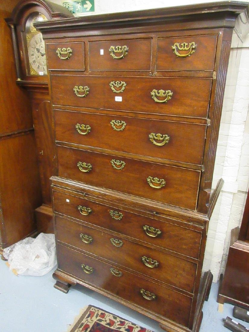 George III mahogany chest on chest, the moulded cornice