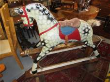 Early 20th Century wooden rocking horse on stained pine
