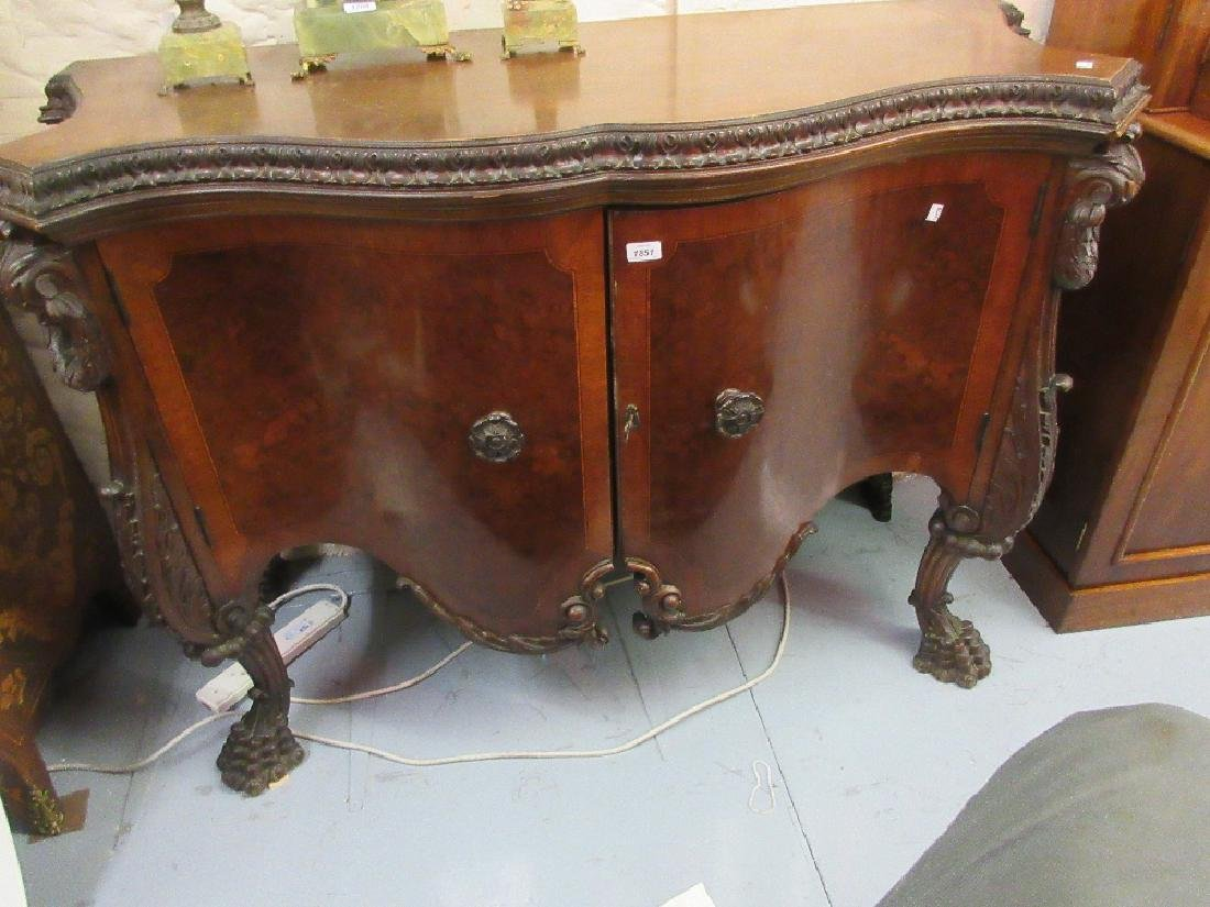 Continental walnut serpentine fronted two door commode