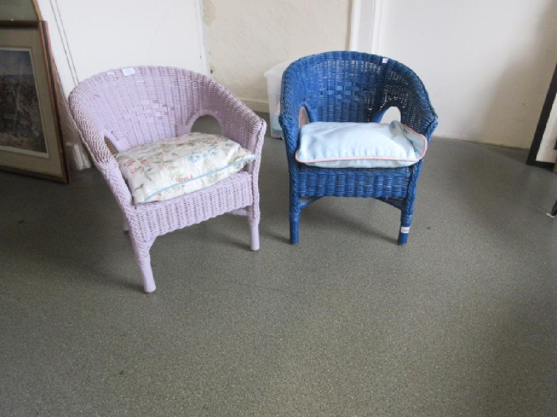 Two child's painted wicker armchairs with loose