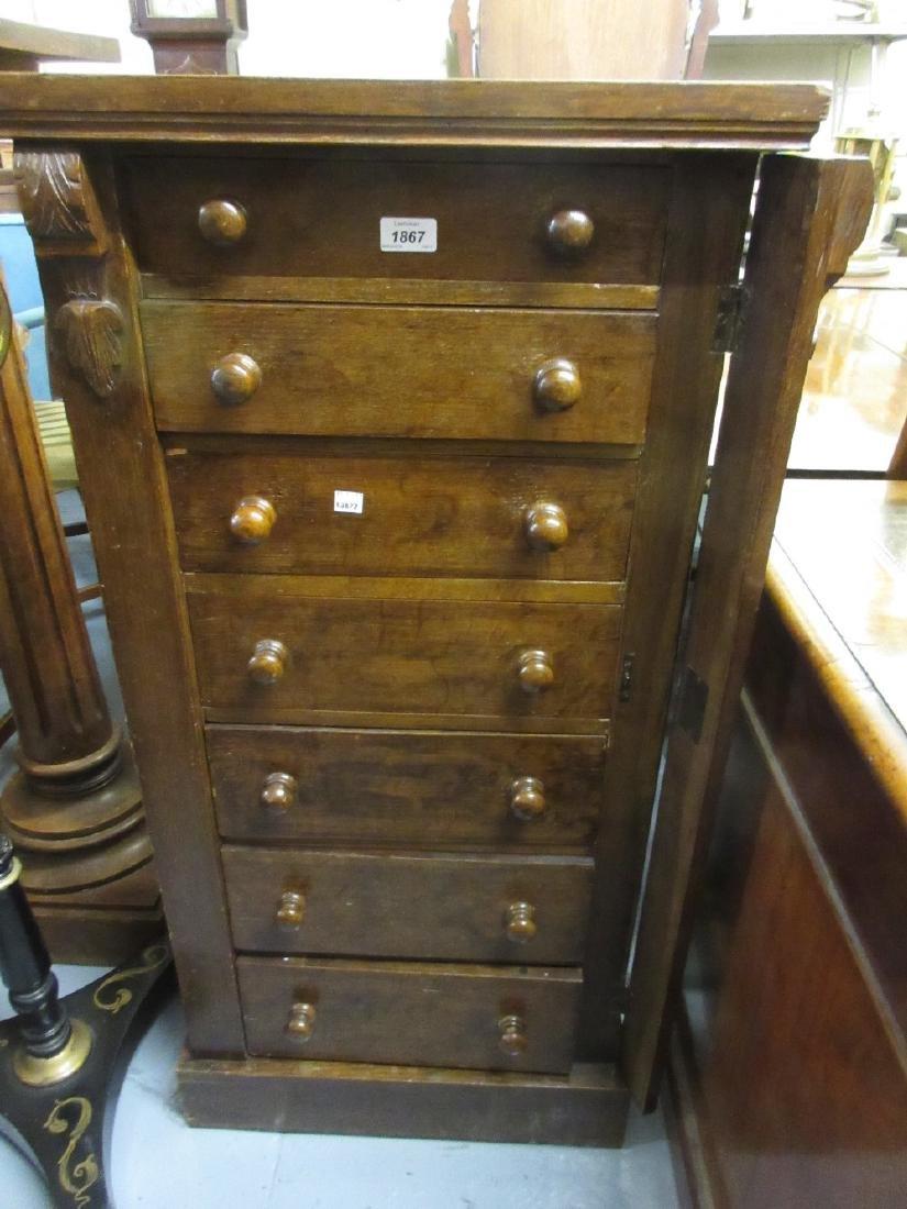 Victorian oak Wellington chest of seven graduated