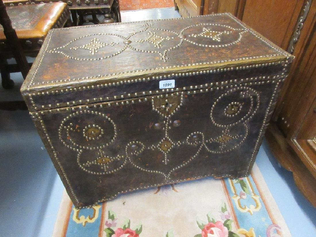 19th Century brown leather and brass studded trunk,