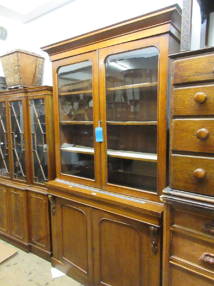 Victorian oak bookcase, the moulded cornice above a