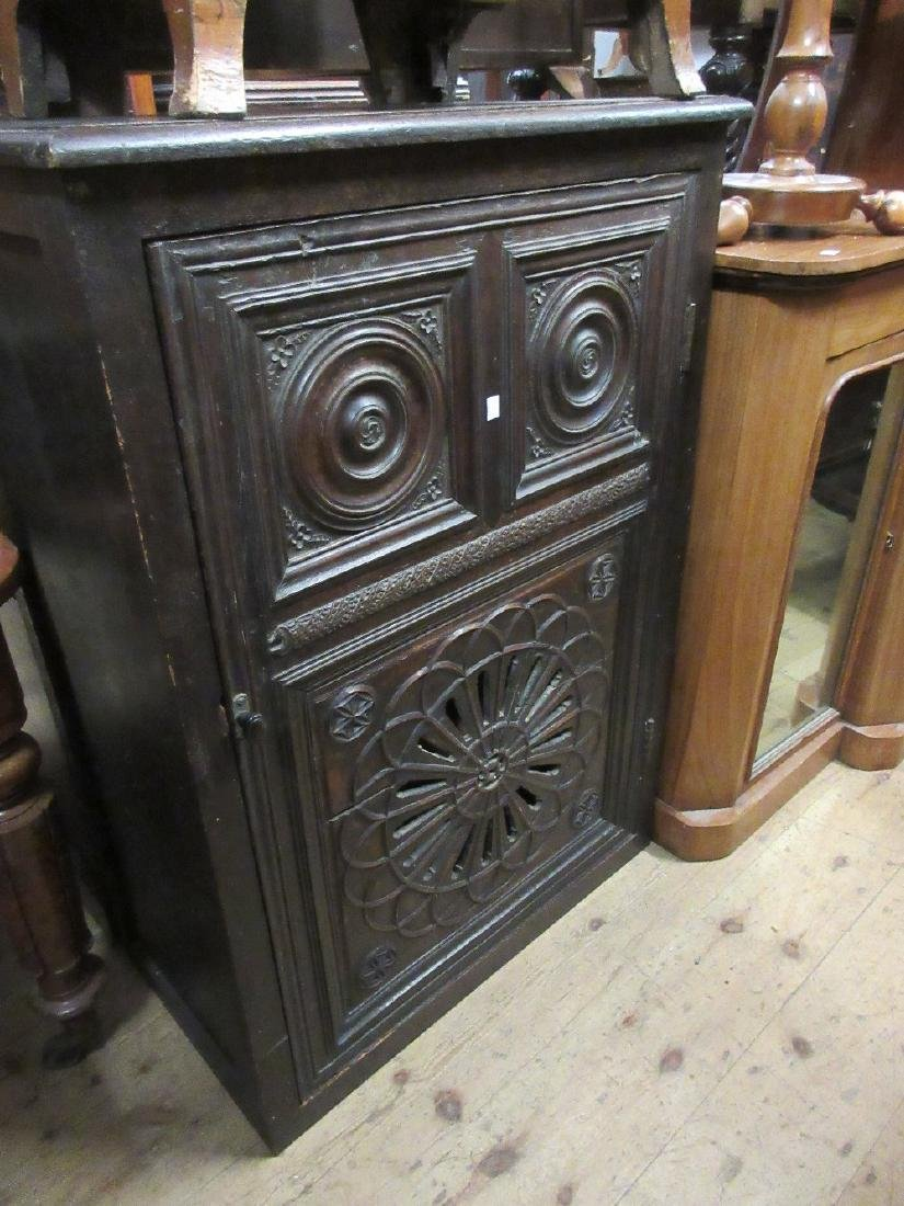Oak side cabinet, the moulded top above an antique