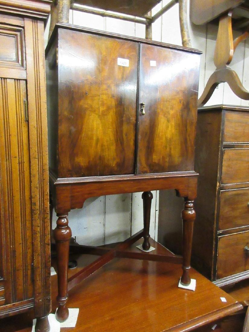 Small early 20th Century walnut and mahogany two door