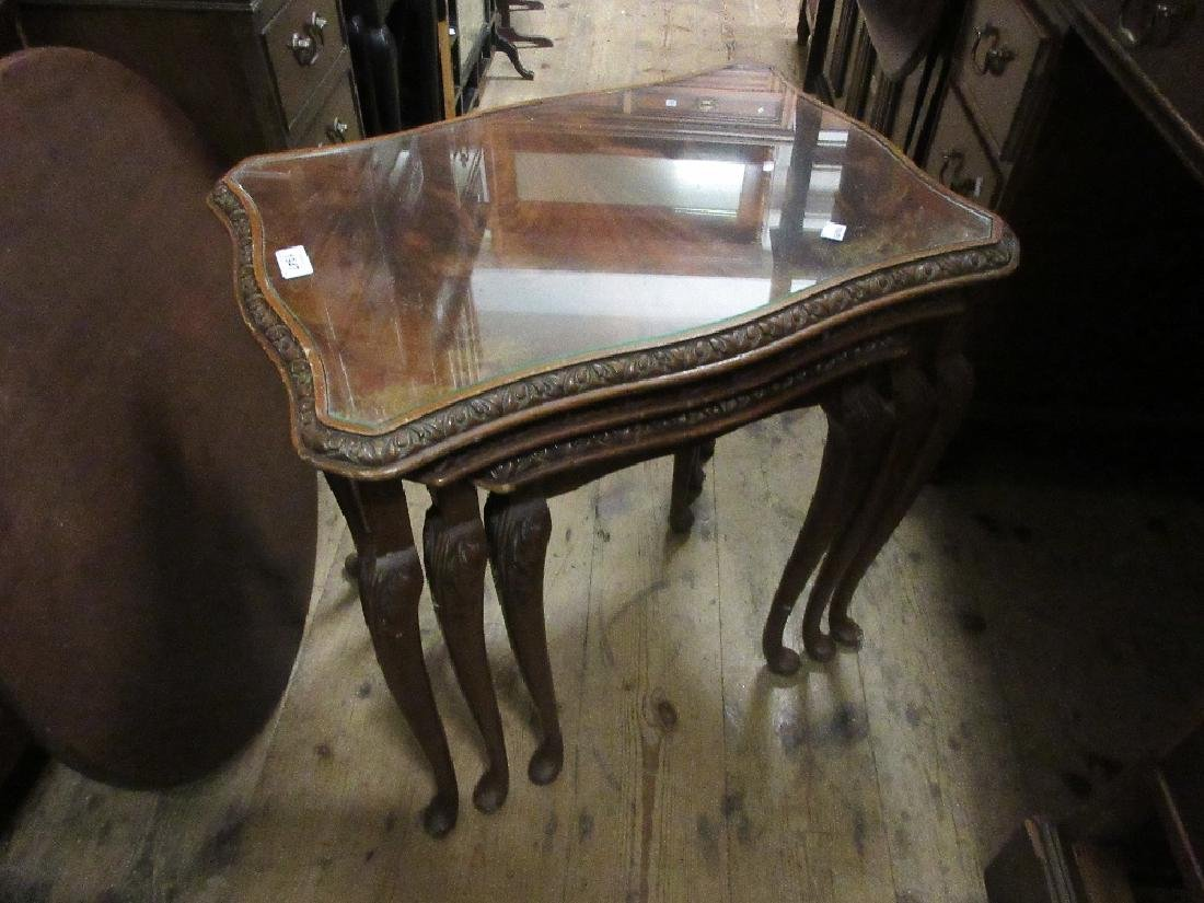Nest of three mahogany coffee tables with glass
