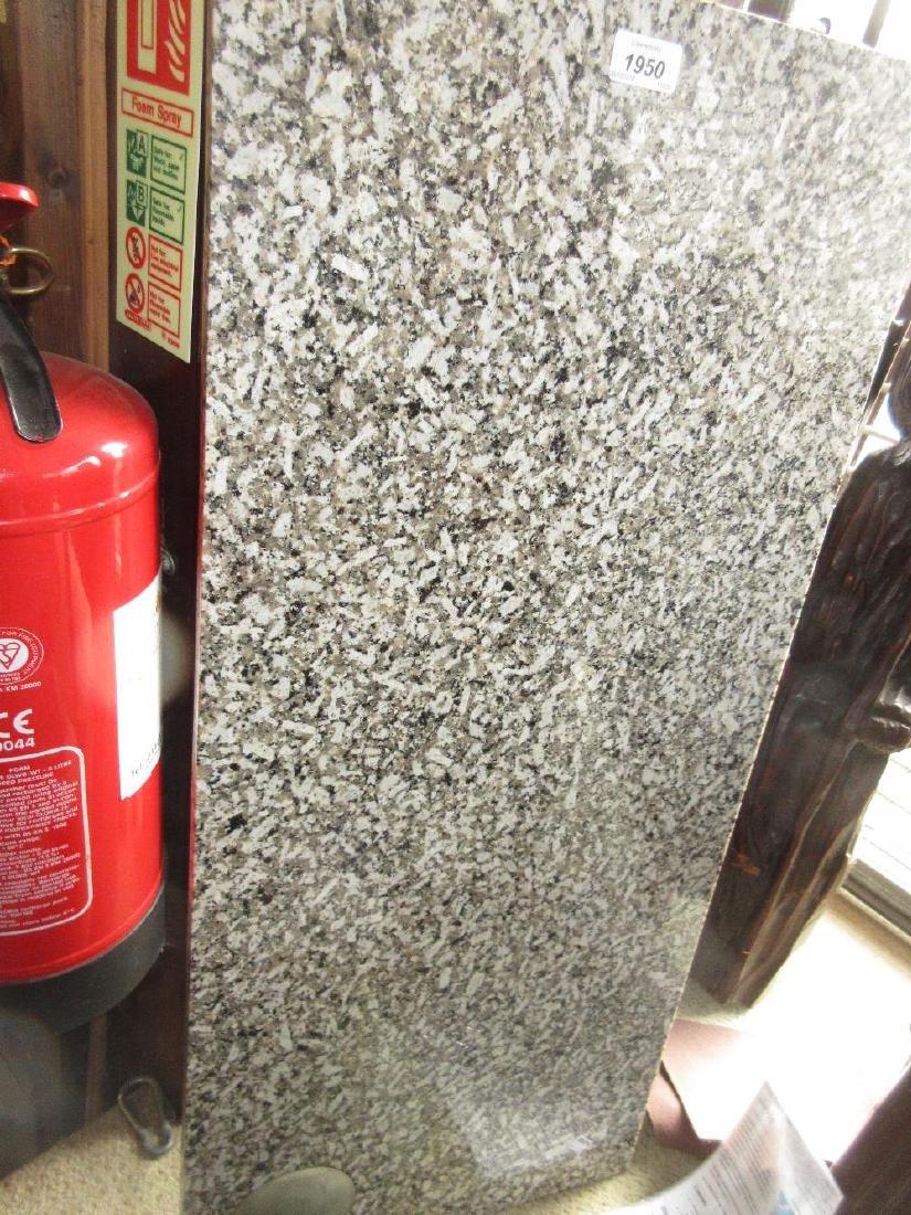 Rectangular polished granite slab bearing a silver